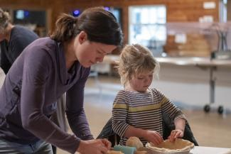 Eloise Girard of Craftsbury and her daughter, Beatrice, roll pie crusts at Sterling College in Craftsbury.